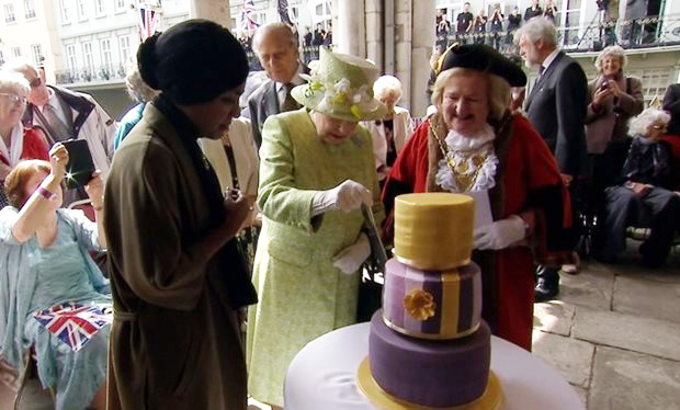 The_Queen_cuts_into_birthday_cake_made_by_Bake_Off_winner_Nadiya_Hussain